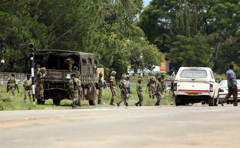 Zimbabwean soldiers are situated where police are clashing with protestors over fuel hikes in Harare, Zimbabwe, Monday, Jan. (AP Photo/Tsvangirayi Mukwazhi)