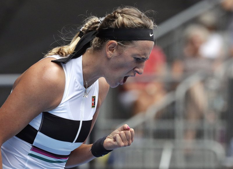 Victoria Azarenka of Belarus reacts after winning a point during her first round match against Germany's Laura Siegemund at the Australian Open tennis championships in Melbourne, Australia, Tuesday, Jan. (AP Photo/Aaron Favila)