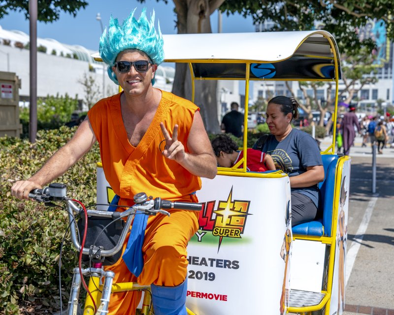 FILE - In this July 20, 2018 file photo, a pedicab driver dressed as a character from the anime franchise