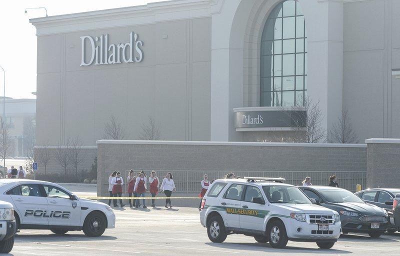 Police escort employees from Dillard's out of the Fashion Place Mall in Murray, Utah, after a shooting on Sunday, Jan. (Francisco Kjolseth/The Salt Lake Tribune via AP)