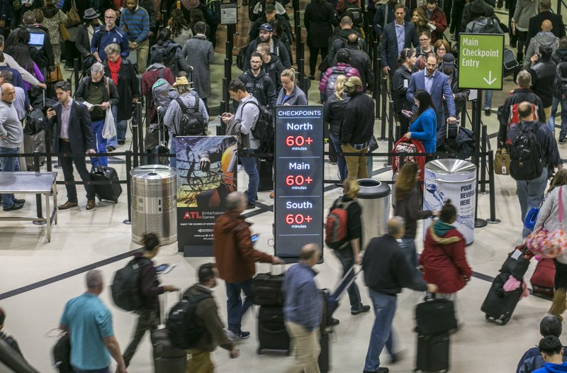 Security lines at Hartsfield-Jackson International Airport in Atlanta stretch more than an hour long amid the partial federal shutdown, causing some travelers to miss flights, Monday morning, Jan. (John Spink/Atlanta Journal-Constitution via AP)