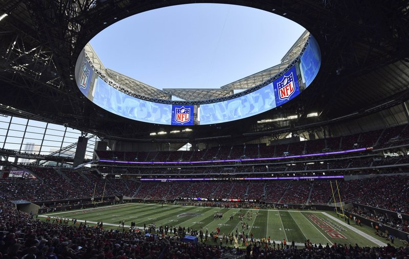 In this Sunday, Dec. 2, 2018, photo, the Atlanta Falcons play the Baltimore Ravens in the Mercedes-Benz stadium during the second half of an NFL football game, in Atlanta. (AP Photo/Danny Karnik)