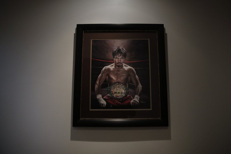 A framed portrait of boxer Manny Pacquiao hangs in the foyer of Pacquiao's home Monday, Jan. 14, 2019, in Los Angeles. (AP Photo/Jae C. Hong)