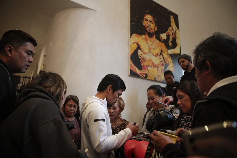 Boxer Manny Pacquiao is surrounded by guests at his home Monday, Jan. 14, 2019, in Los Angeles.  (AP Photo/Jae C. Hong)