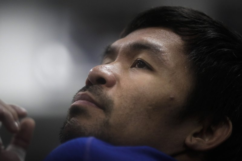 Boxer Manny Pacquiao stretches before his workout at the Wild Card Boxing Club Monday, Jan. 14, 2019, in Los Angeles. (AP Photo/Jae C. Hong)