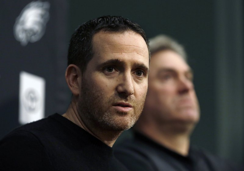 Howie Roseman, left, executive vice president of football operations for the Philadelphia Eagles NFL football team, answers a reporter's question alongside coach Doug Pederson during a news conference Tuesday Jan. (AP Photo/Jacqueline Larma)