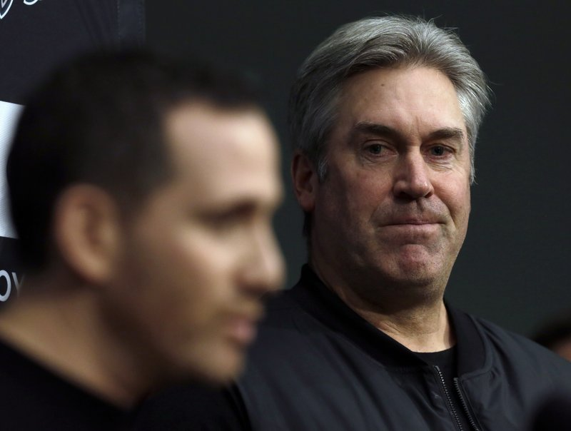 Howie Roseman, left, executive vice president of football operations of the Philadelphia Eagles NFL football team, answers a reporter's question alongside coach Doug Peterson during a news conference Tuesday Jan. (AP Photo/Jacqueline Larma)