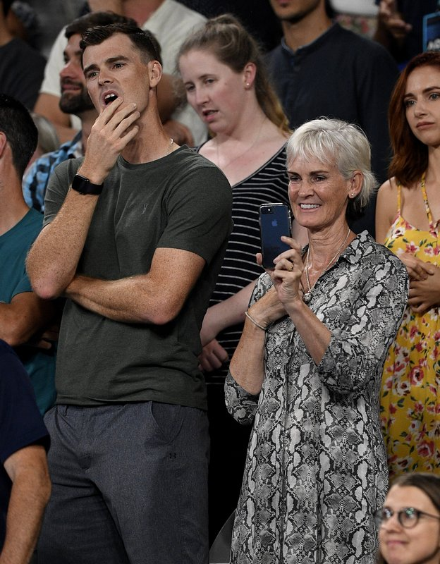 Jamie and Judy Murray watch a presentation for Britain's Andy Murray following his first round loss to Spain's Roberto Bautista Agut at the Australian Open tennis championships in Melbourne, Australia, Monday, Jan. (AP Photo/Andy Brownbill)
