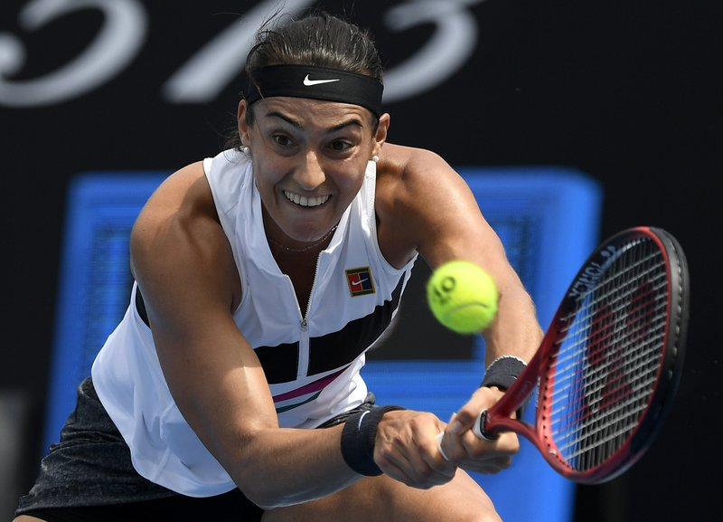 France's Caroline Garcia makes a backhand return to Australia's Zoe Hives during their second round match at the Australian Open tennis championships in Melbourne, Australia, Wednesday, Jan. (AP Photo/Andy Brownbill)