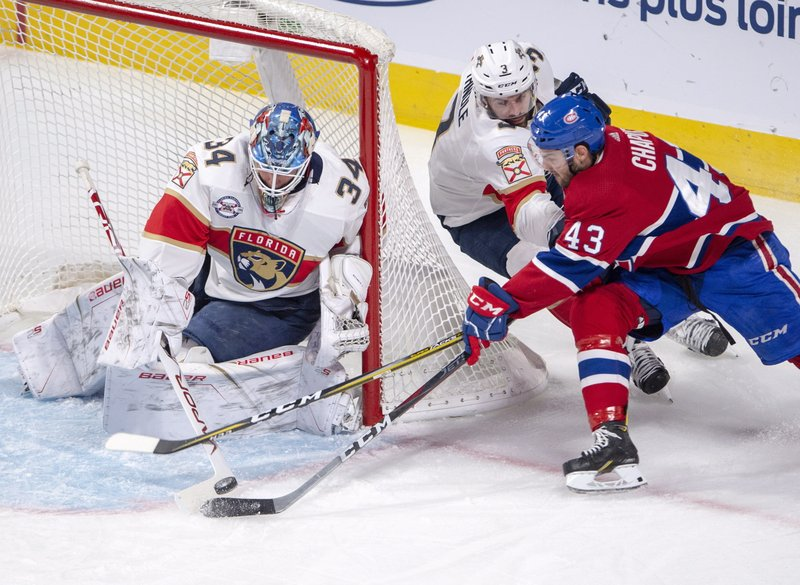 Florida Panthers goaltender James Reimer (34) and Florida Panthers defenseman Keith Yandle (3) stop Montreal Canadiens center Michael Chaput (43) during the second period of an NHL hockey game, Tuesday, Jan. (Ryan Remiorz/The Canadian Press via AP)