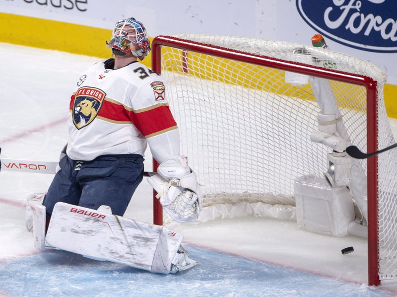 Florida Panthers goaltender James Reimer (34) reacts after letting in the second goal during the second period of an NHL hockey game against the Montreal Canadiens, Tuesday, Jan. (Ryan Remiorz/The Canadian Press via AP)