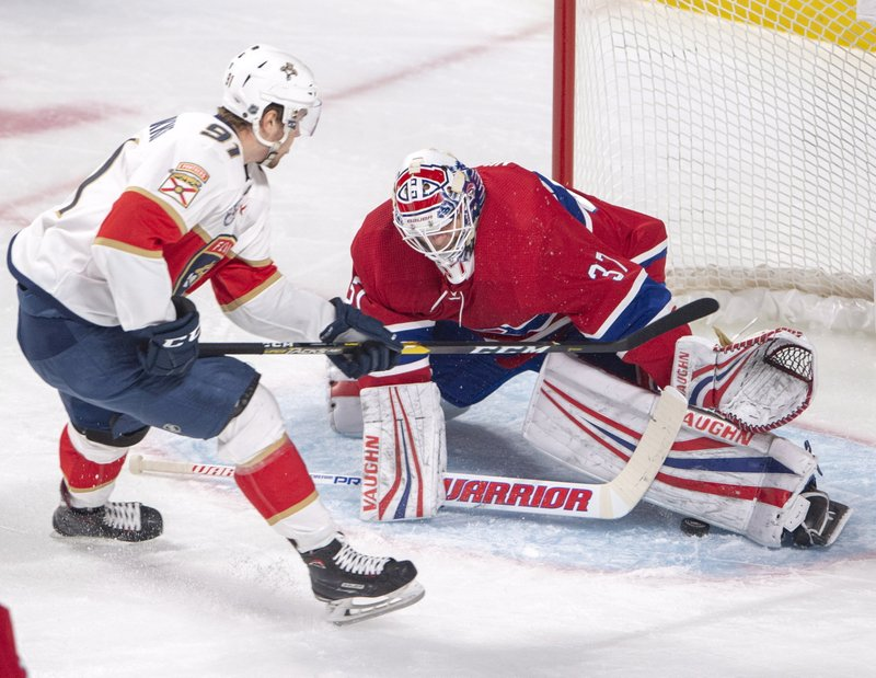 Montreal Canadiens goaltender Antti Niemi (37) makes the save on Florida Panthers right wing Juho Lammikko (91) during the first period of an NHL hockey game,Tuesday, Jan. (Ryan Remiorz/The Canadian Press via AP)