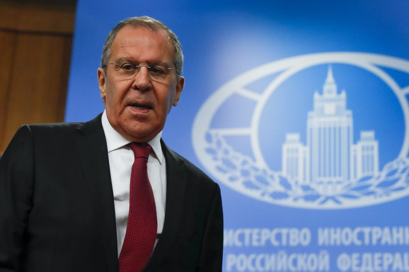 Russian Foreign Minister Sergey Lavrov arrives to attend an annual roundup news conference about his department's 2018 accomplishments in Moscow, Russia, Wednesday, Jan. (AP Photo/Pavel Golovkin)