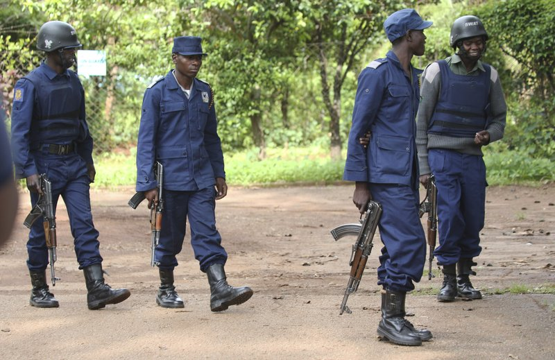 Armed police officers outside the residence of Evan Mawarire, an activist and pastor who helped mobilize people to protest against the hike in fuel prices, following his arrest in Harare, Zimbabwe, Wednesday, Jan. (AP Photo/Tsvangirayi Mukwazhi)