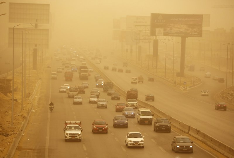 Vehicles drive during a sandstorm in Cairo, Egypt, Wednesday, Jan. 16, 2019 as a thick sandstorm cloaked parts of the Middle East. (AP Photo/Amr Nabil)