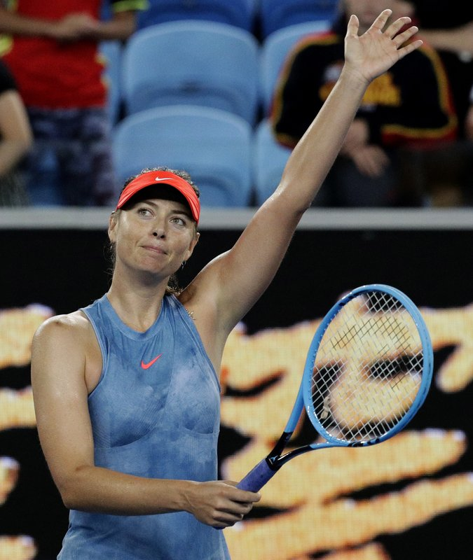 Russia's Maria Sharapova celebrates after defeating Sweden's Rebecca Peterson in their second round match at the Australian Open tennis championships in Melbourne, Australia, Thursday, Jan. (AP Photo/Aaron Favila)