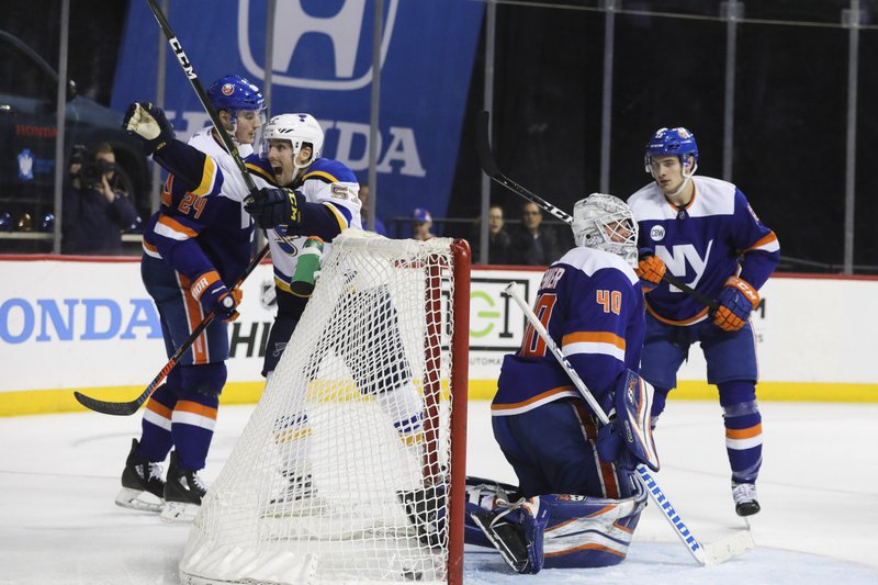 St. Louis Blues left wing David Perron (57) celebrates after scoring on New York Islanders goaltender Robin Lehner during the third period of an NHL hockey game, Tuesday, Jan. (AP Photo/Kevin Hagen)