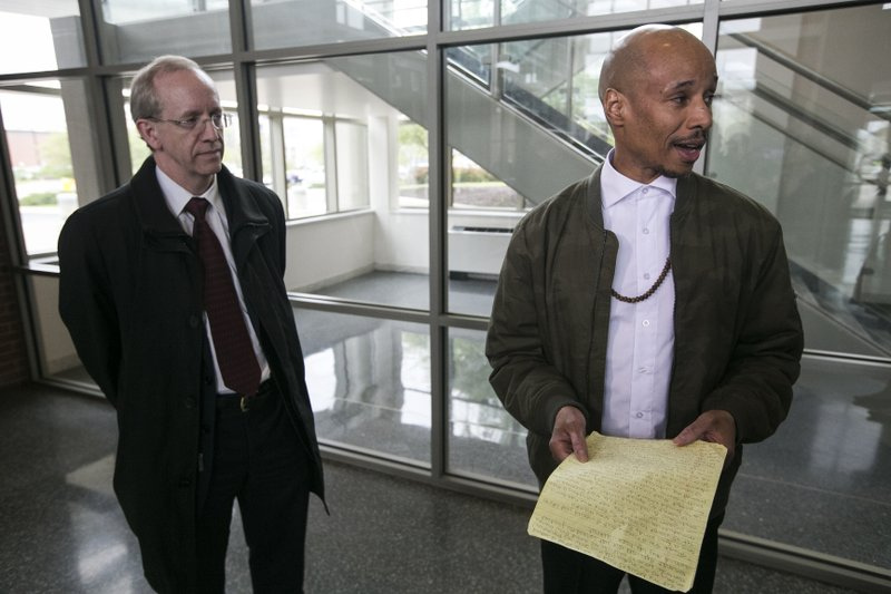 In this April 27, 2017 photo, Patrick Pursley, right, speaks to the media, as Robert Stauffer, one of his lawyers, listens after Pursley was released from the Winnebago County jail in Rockford, Ill. (Arturo Fernandez/Rockford Register Star via AP)