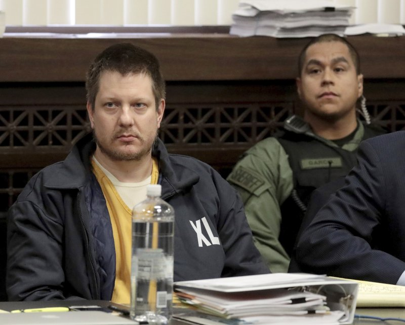 FILE - in this Dec. 14, 2018, file photo, former Chicago police Officer Jason Van Dyke, left, appears for a hearing at the Leighton Criminal Court Building, in Chicago. (Antonio Perez/Chicago Tribune via AP, Pool, File)