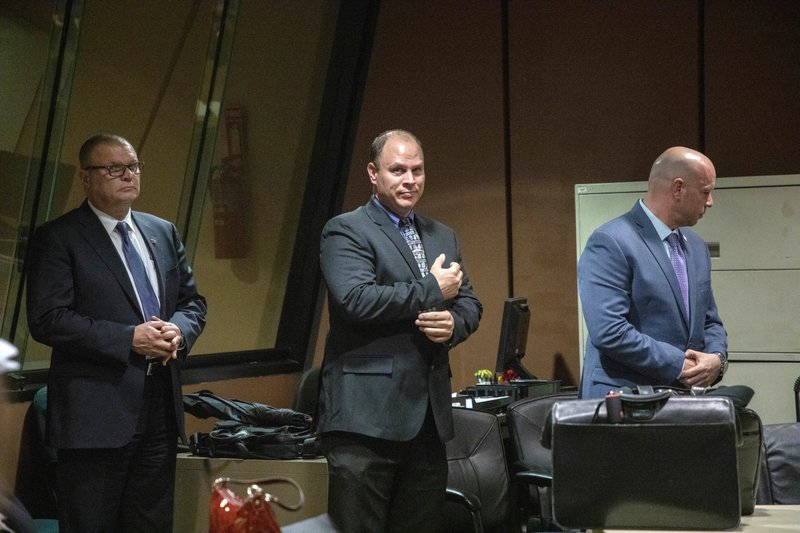 FILE - In this Oct. 30, 2018 file photo, from left, former Detective David March, Chicago Police Officer Thomas Gaffney and former officer Joseph Walsh appear at a pre-trial hearing in Chicago. (Zbigniew Bzdak/Chicago Tribune via AP, Pool File)