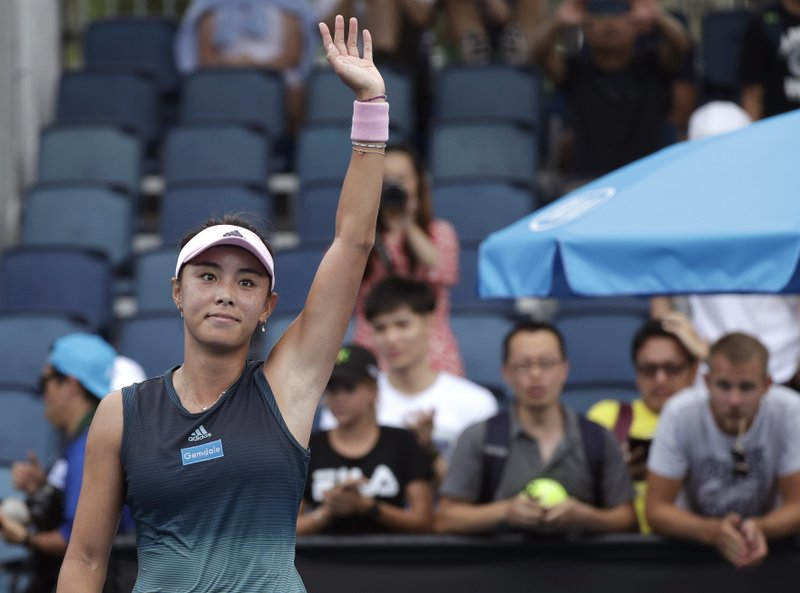 China's Wang Qiang waves after defeating Serbia's Aleksandra Krunic in their second round match at the Australian Open tennis championships in Melbourne, Australia, Thursday, Jan. (AP Photo/Kin Cheung)