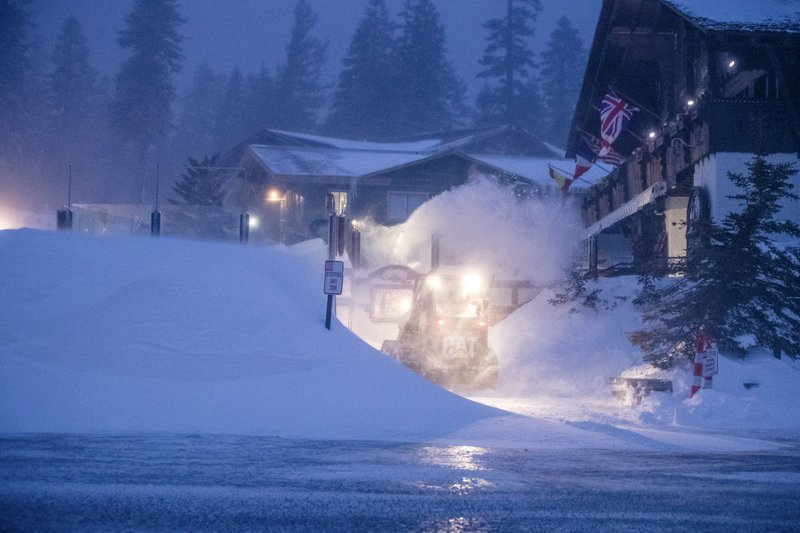 This photo provided by Mammoth Mountain Ski Area shows clearing fresh snow fall on Wednesday, Jan. 16, 2019, at Mammoth Mountain in Mammoth Lakes, Calif. (Peter Morning/Mammoth Mountain Ski Area via AP)