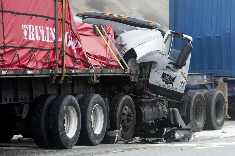 Damaged trucks remain on Interstate 15 after a multi-car collision in the Cajon Pass near Hesperia Calif. (James Quigg/The Daily Press via AP)