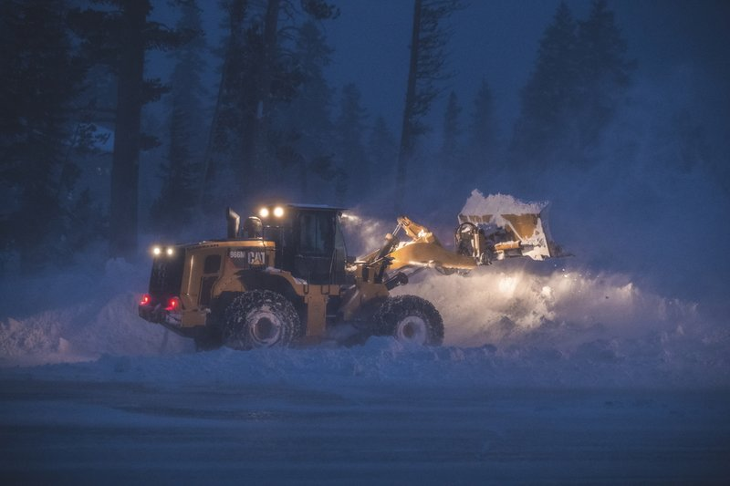 This photo provided by Mammoth Mountain Ski Area shows crew clearing fresh snow fall at Mammoth Mountain ski area, in Mammoth Lakes, Calif. (Peter Morning/Mammoth Mountain Ski Area via AP)