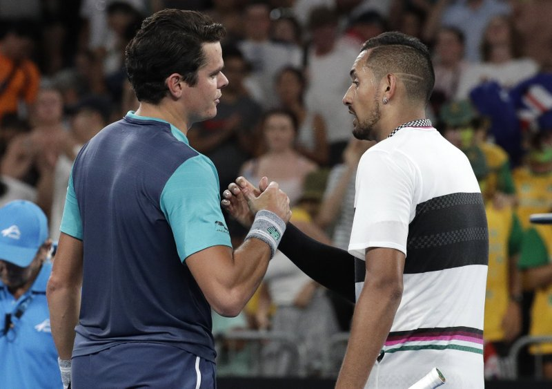 Canada's Milos Raonic, left, is congratulated by Australia's Nick Kyrgios after winning their first round match at the Australian Open tennis championships in Melbourne, Australia, Tuesday, Jan. (AP Photo/Aaron Favila)