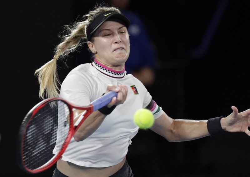 Canada's Eugenie Bouchard hits a forehand return to United States' Serena Williams during their second round match at the Australian Open tennis championships in Melbourne, Australia, Thursday, Jan. (AP Photo/Aaron Favila)