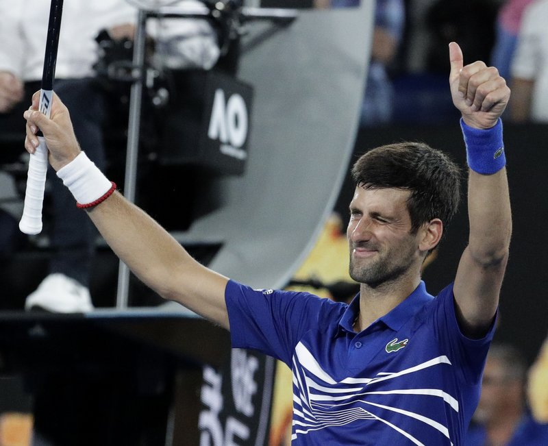Serbia's Novak Djokovic celebrates after defeating France's Jo-Wilfried Tsonga during their second round match at the Australian Open tennis championships in Melbourne, Australia, Friday, Jan. (AP Photo/Aaron Favila)
