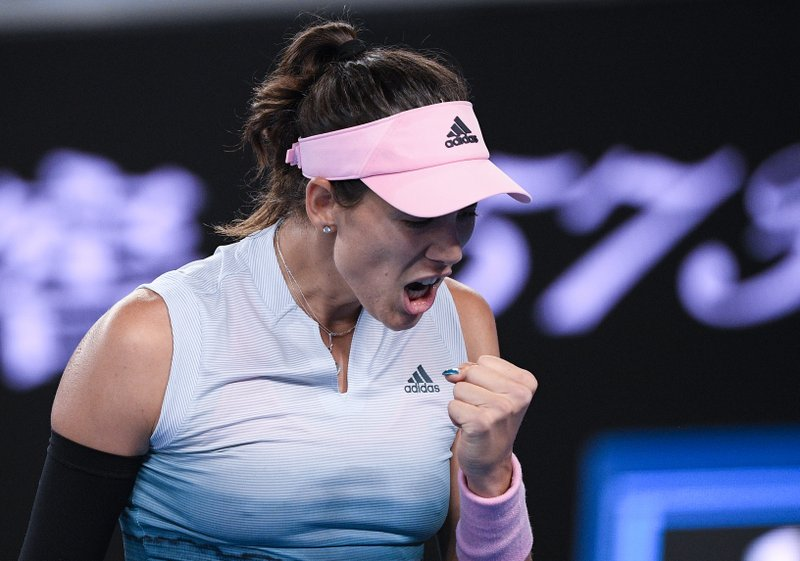 Spain's Garbine Muguruza reacts after winning a point against Britain's Johanna Konta during their second round match at the Australian Open tennis championships in Melbourne, Australia, Friday, Jan. (AP Photo/Andy Brownbill)