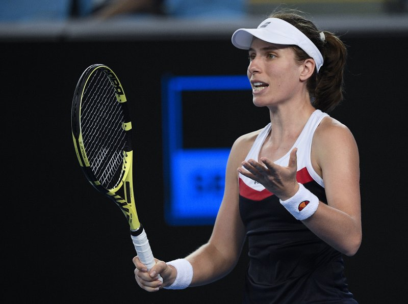 Britain's Johanna Konta reacts during her second round match against Spain's Garbine Muguruza at the Australian Open tennis championships in Melbourne, Australia, Friday, Jan. (AP Photo/Andy Brownbill)