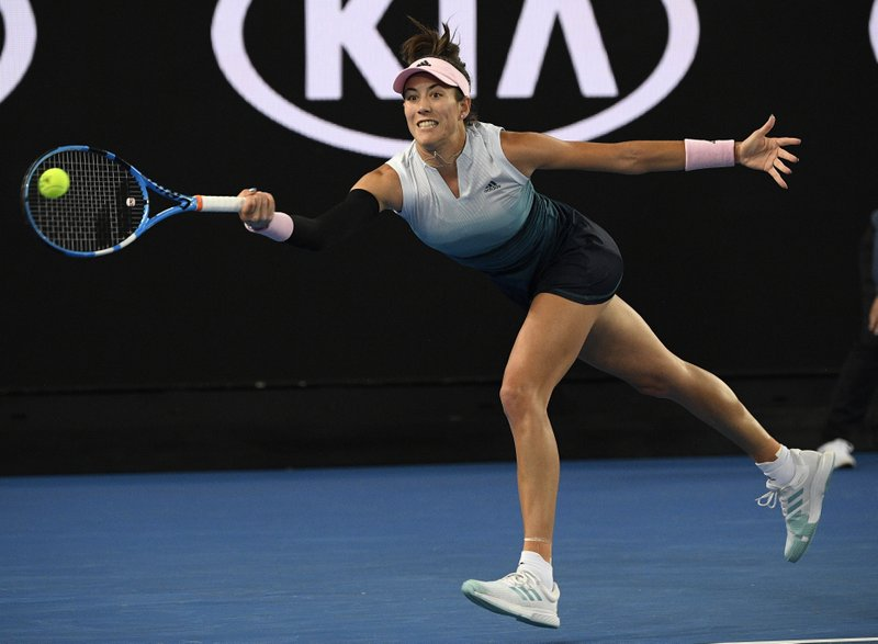 Spain's Garbine Muguruza makes a forehand return to Britain's Johanna Konta during their second round match at the Australian Open tennis championships in Melbourne, Australia, Friday, Jan. (AP Photo/Andy Brownbill)