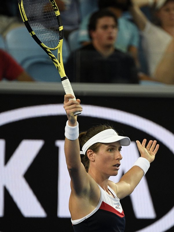 Britain's Johanna Konta gestures during her second round match against Spain's Garbine Muguruza at the Australian Open tennis championships in Melbourne, Australia, Friday, Jan. (AP Photo/Andy Brownbill)