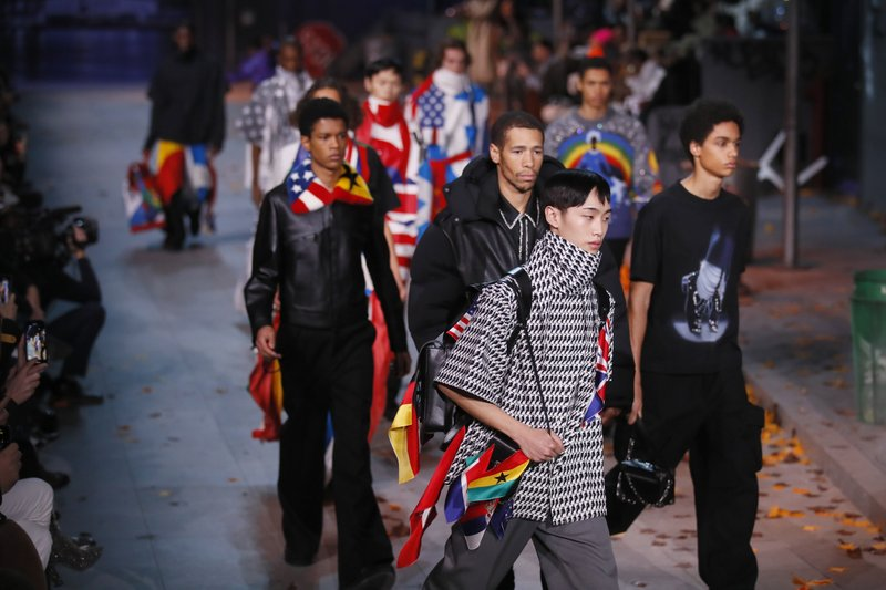 Models wear creations for the Vuitton men's Fall/Winter 2019/20 fashion collection presented in Paris, Thursday Jan. (AP Photo/Francois Mori)