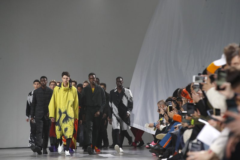 Models wear creations for the Miyake men's Fall/Winter 2019/20 fashion collection presented in Paris, Thursday Jan. (AP Photo/Christophe Ena)
