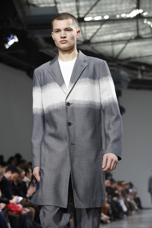 A model wears a creation for the Miyake men's Fall/Winter 2019/20 fashion collection presented in Paris, Thursday Jan. (AP Photo/Christophe Ena)