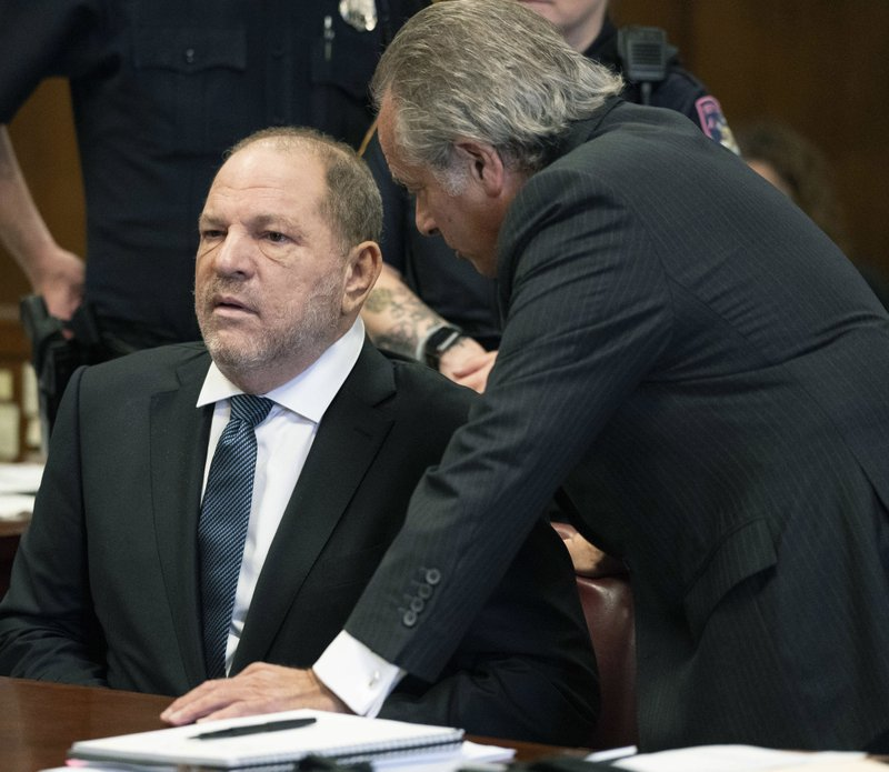 FILE- In this Oct. 11, 2018 file photo, Harvey Weinstein, left, talks with his attorney Benjamin Brafman during his hearing in a New York City courtroom. (Steven Hirsch New York Post via AP, Pool, File)