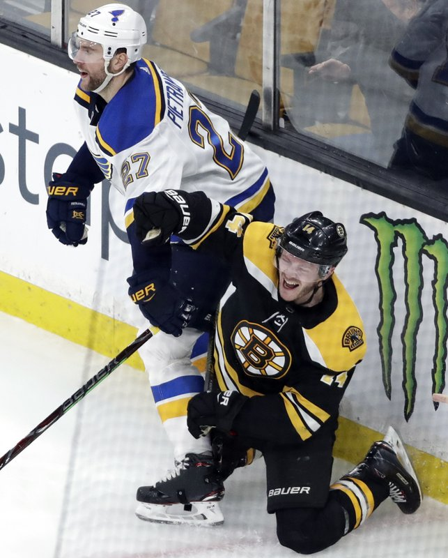 Boston Bruins right wing Chris Wagner (14) celebrates his goal next to St. Louis Blues defenseman Alex Pietrangelo (27) during the third period of an NHL hockey game Thursday, Jan. (AP Photo/Elise Amendola)