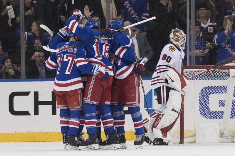Chicago Blackhawks goaltender Collin Delia (60) reacts as the New York Rangers celebrate a goal by right wing Mats Zuccarello during the first period of an NHL hockey game Thursday, Jan. (AP Photo/Mary Altaffer)