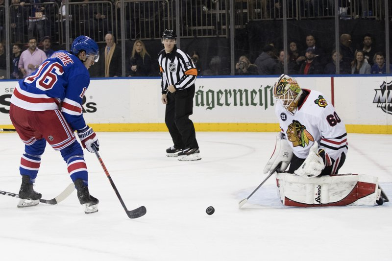 Chicago Blackhawks goaltender Collin Delia (60) makes a save against New York Rangers center Ryan Strome (16) during the second period of an NHL hockey game Thursday, Jan. (AP Photo/Mary Altaffer)