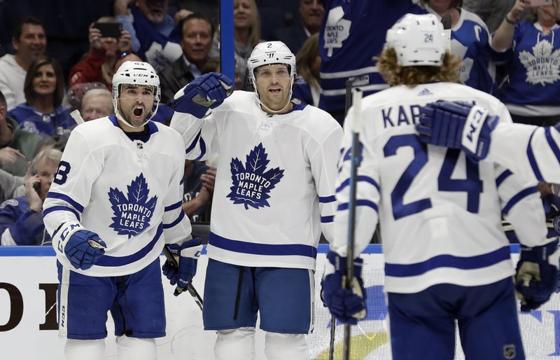 Toronto Maple Leafs center Nazem Kadri (43) celebrates his goal against the Tampa Bay Lightning with defenseman Ron Hainsey (2) and right wing Kasperi Kapanen (24) during the first period of an NHL hockey game, Thursday, Jan. (AP Photo/Chris O'Meara)