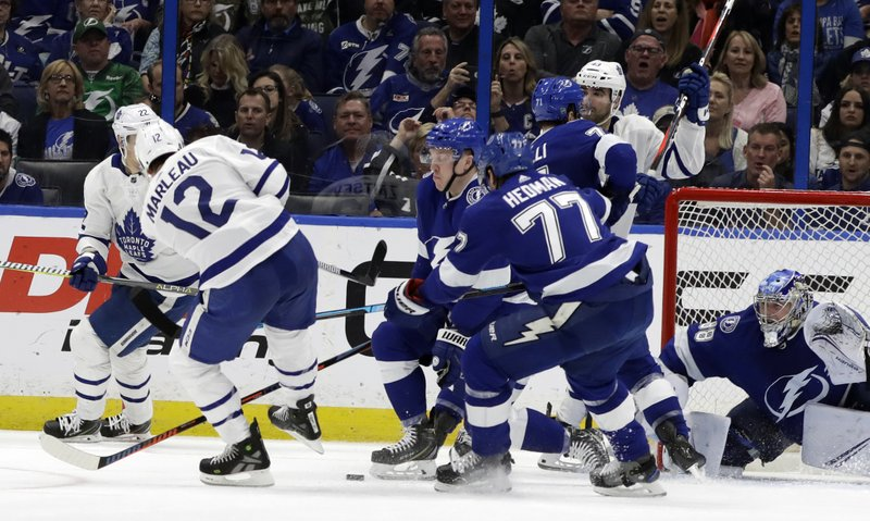 Toronto Maple Leafs center Patrick Marleau (12) watches his shot eventually get past Tampa Bay Lightning goaltender Andrei Vasilevskiy (88) for a goal during the second period of an NHL hockey game, Thursday, Jan. (AP Photo/Chris O'Meara)