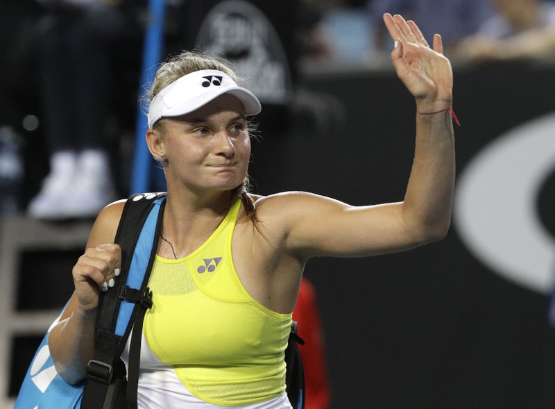 Ukraine's Dayana Yastremska waves as she leaves the court after defeating Spain's Carla Suarez Navarro in their second round match at the Australian Open tennis championships in Melbourne, Australia, Thursday, Jan. (AP Photo/Mark Schiefelbein)