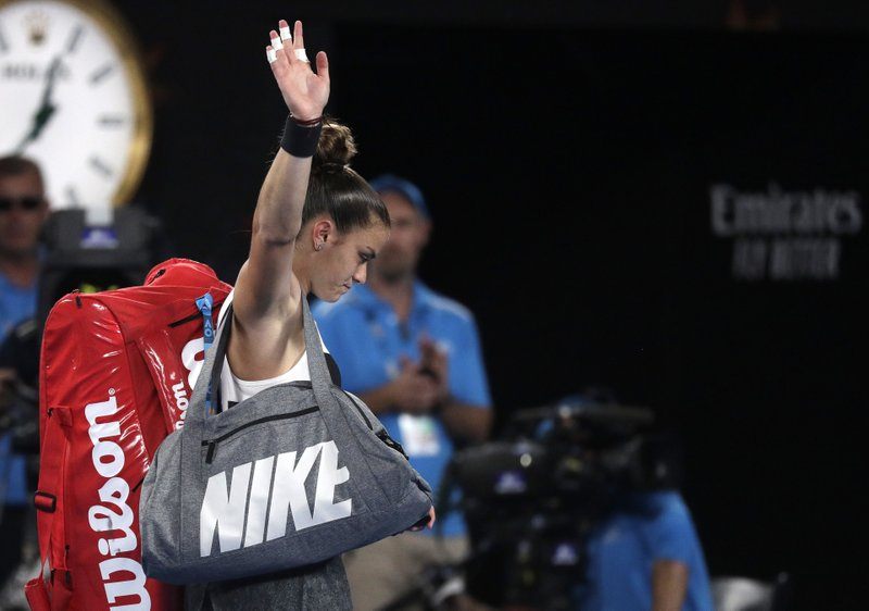 Greece's Maria Sakkari waves as she leaves Rod Laver Arena after losing her third round match Australia's Ashleigh Barty at the Australian Open tennis championships in Melbourne, Australia, Friday, Jan. (AP Photo/Kin Cheung)