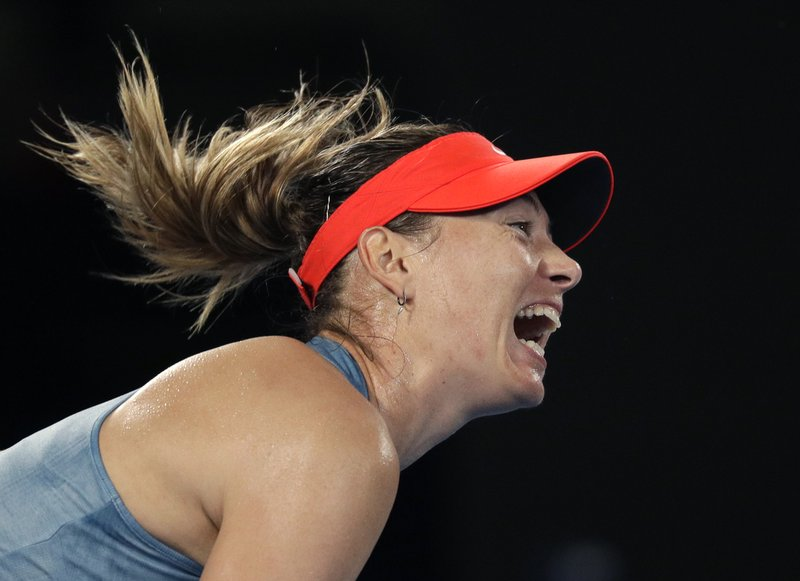 Russia's Maria Sharapova serves to Denmark's Caroline Wozniacki during their third round match at the Australian Open tennis championships in Melbourne, Australia, Friday, Jan. (AP Photo/Kin Cheung)
