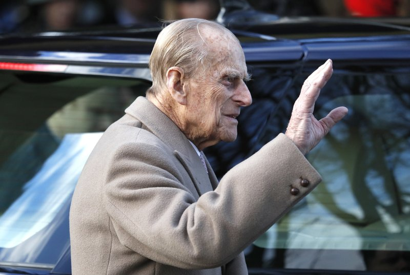 FILE - In this Sunday, Dec. 25, 2016 file photo, Britain's Prince Philip waves to the public as he leaves after attending a Christmas day church service in Sandringham, England. (AP Photo/Kirsty Wigglesworth, file)