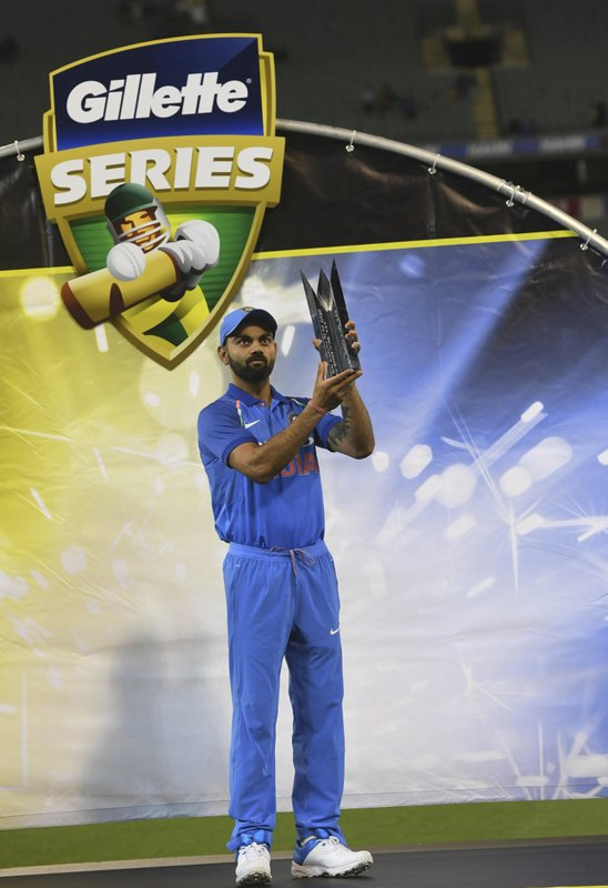 India's Virat Kohli poses with the Border–Gavaskar Trophy during their one day international cricket match against Australia in Melbourne, Australia, Friday, Jan. (AP Photo/Mal Fairclough)