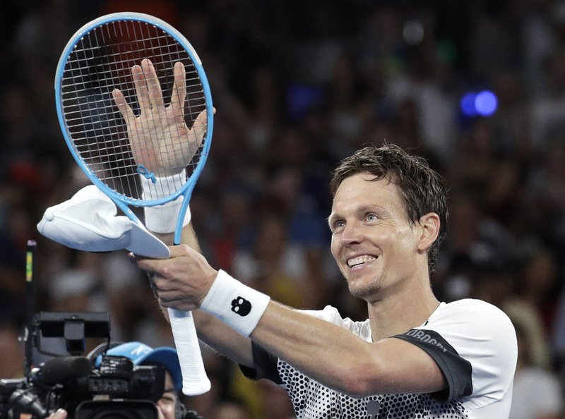 Tomas Berdych of the Czech Republic celebrates after defeating Argentina's Diego Schwartzman during their third round match at the Australian Open tennis championships in Melbourne, Australia, Friday, Jan. (AP Photo/Aaron Favila)